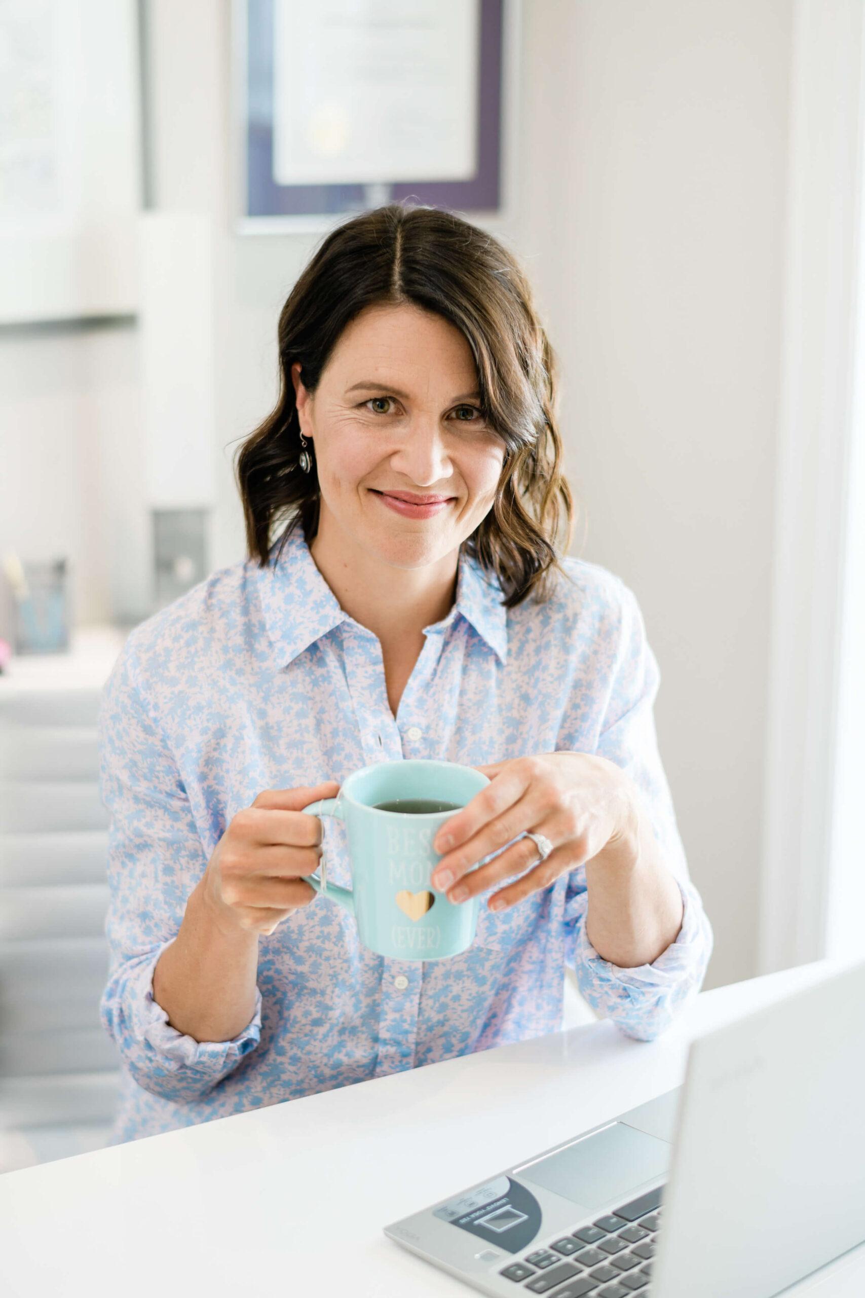 Katie holding a mug of coffee